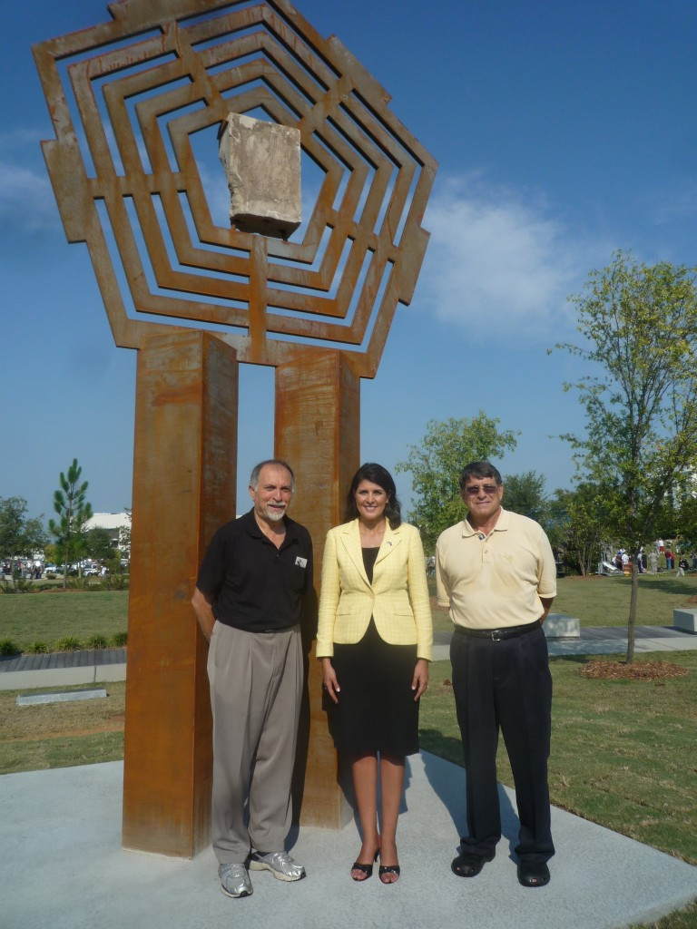 Alex Palkovich with South Carolina Governor Nikki Haley, and Barry Wingard, standing in front of the 9/11 monument he designed