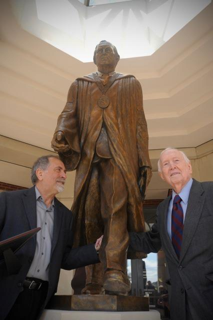 Dr. Doug Smith and Alex at the unveiling of the statue on the FMU campus