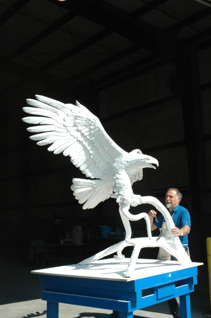Alex is seen working on the completed plaster eagle.