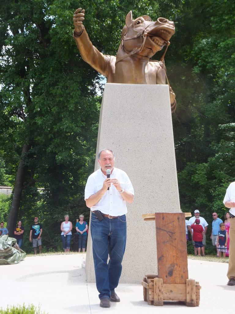 Alex Palkovich speaking in front of the newly unveiled sculpture
