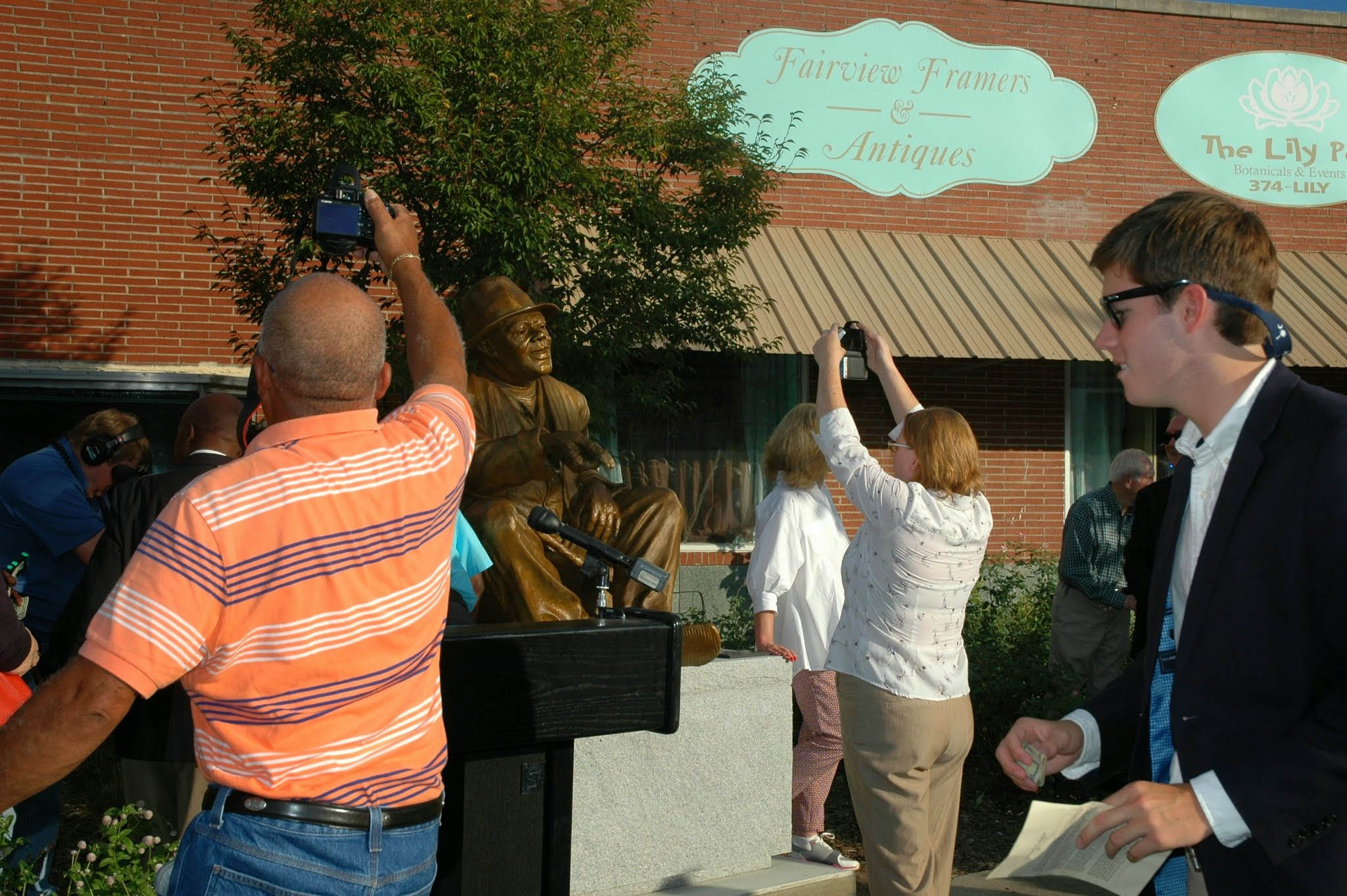 People trying to get the best picture of this latest public sculpture in Lake City, SC.