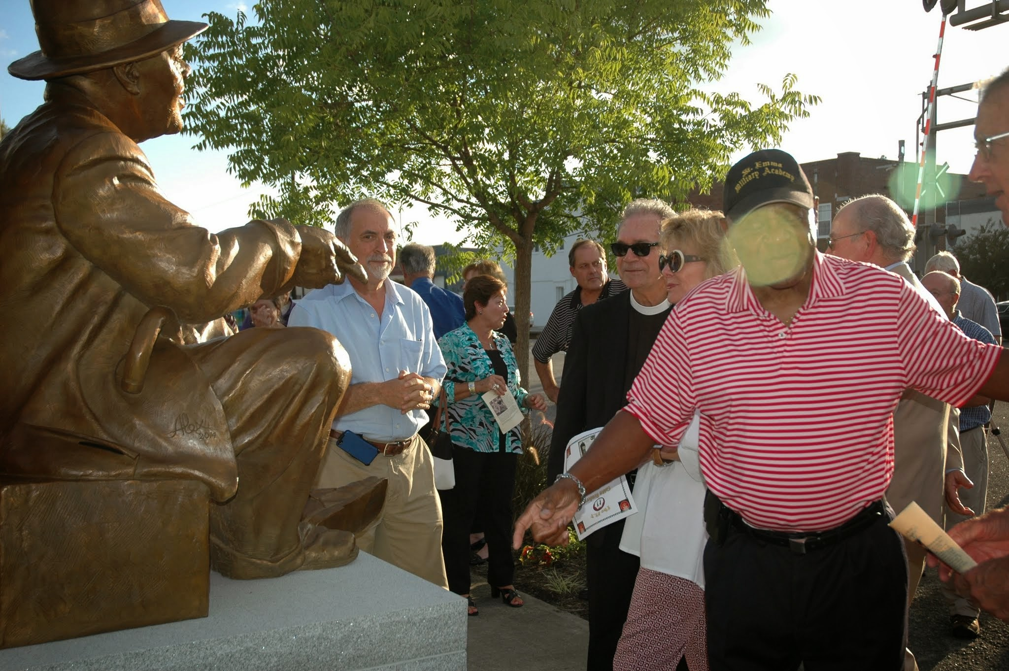 People gathering around the sculpture.