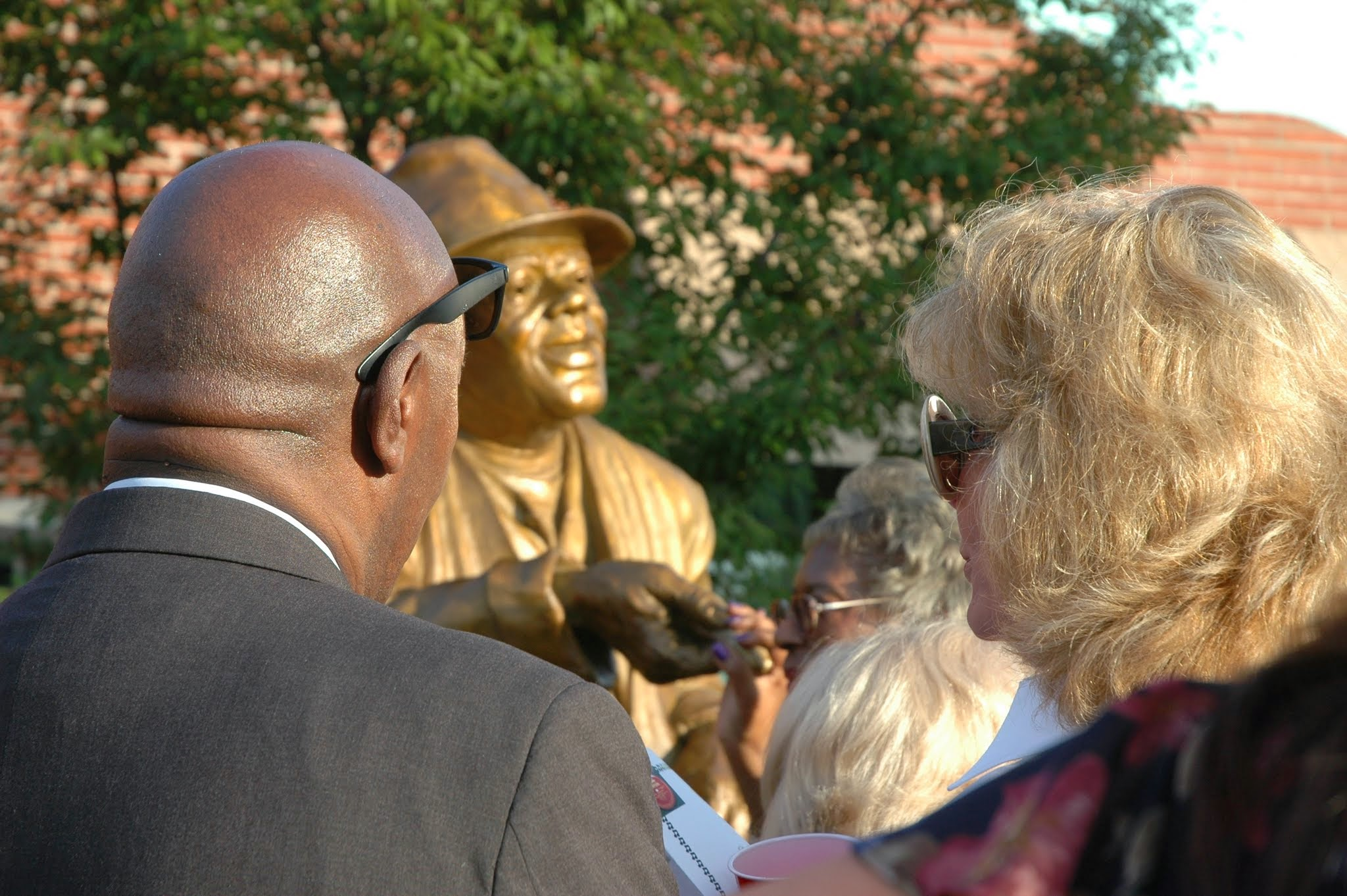 Darla Moore viewing the Huey Cooper sculpture Sept. 10, 2014 at the unveiling